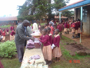 Distributing uniforms to the needy children