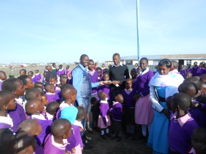 Patrick Hands Over ACH Donations at Osiligi Primary