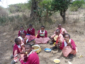 Sponsored girls share a meal